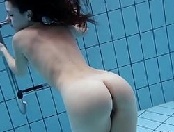 Sexy babe Aneta swims and strips naked