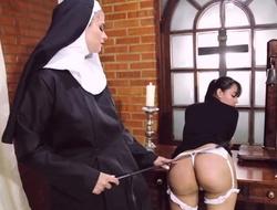 Depreciatory nun bonks her girlfriend with dong sex-toy