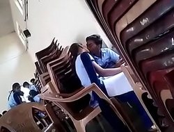 girl added to boy giving a kiss in school