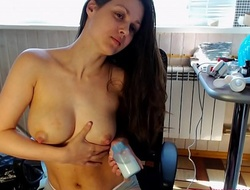 Sexy mom milking in a bottle with an increment of spray milk vulnerable her face from her boobs!