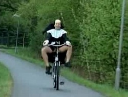 Nun on bike.wmv