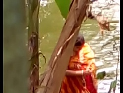 Sexy Bengali boudi soma bathing openly coupled with showing his assets