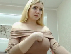busty blonde student girl demonstrates her interior